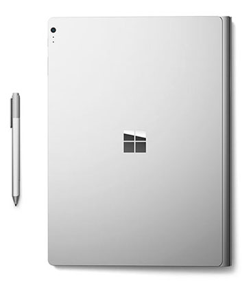 Microsoft Surface Book lid closed showing Magnesium Alloy chassis, rear facing 8 mega pixel camera and pressure sensitive pen displayed.