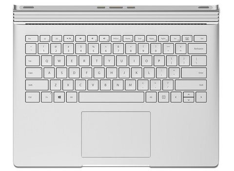 Microsoft Surface Book backlit keyboard with glass touchpad displayed.